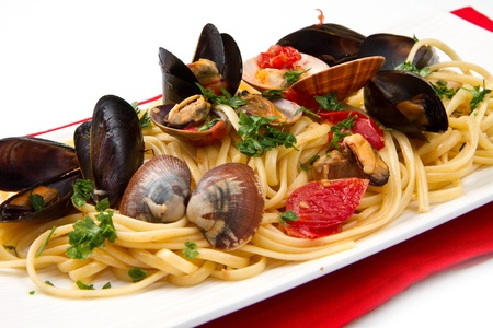 pasta isolated: photo of delicious pasta with clams and mussel Stock Photo