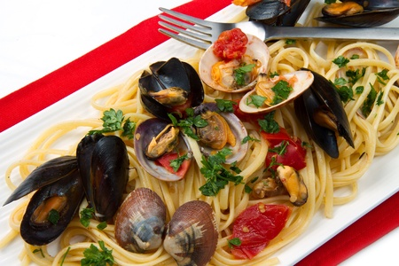 cooked fish: photo of delicious pasta with clams and mussel Stock Photo