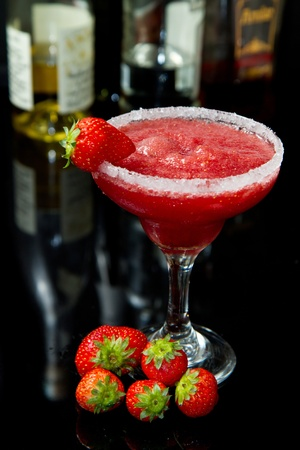 strawberry cocktail on black background