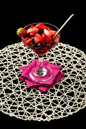 fresh fruit salad on black background photo