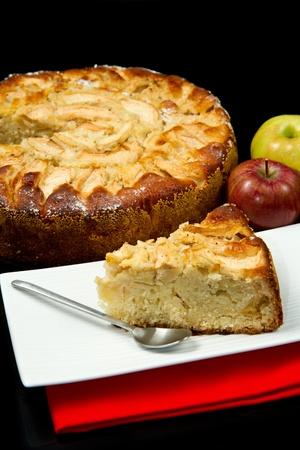 Apple Tart  with fresh apple on black background photo
