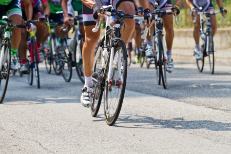 The cyclists riding by at the bicycle race Stock Photo - 10544200