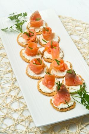 smoked salmon: Canape with Salmon on white dish