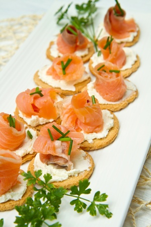 wild mint: Canape with Salmon on white dish