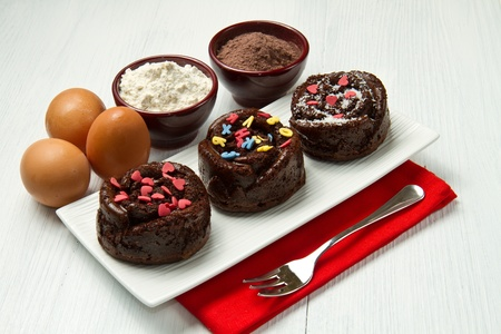 Delicious decorated chocolate muffins photo