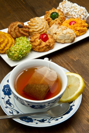 tea cup with biscuits photo