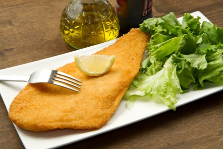 plaice: fillet of fried fish with fresh salad