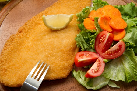 cod oil: fillet of fried fish with fresh salad