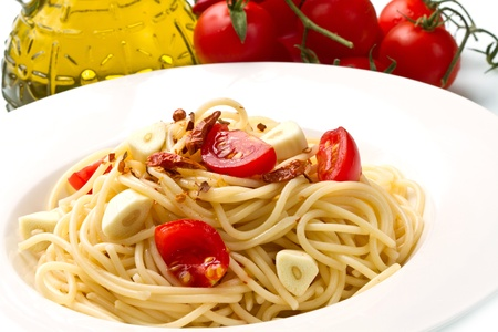 pasta garlic olive oil and red chili pepper closeup on a white dish photo