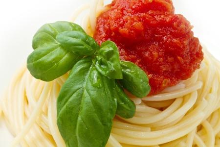 close up food: spaghetti with tomato sauce and basil  Stock Photo