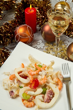 seafood salad on christmas table photo