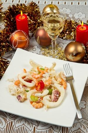 seafood salad on christmas table photo