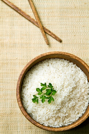 uncooked rice grains in wood bowl  Stock Photo - 11155132