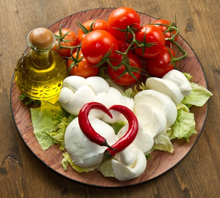 mediterranean cuisine: a fresh italian mozzarella  with tomato Stock Photo