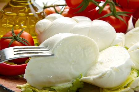 a fresh italian mozzarella  with tomato Stock Photo