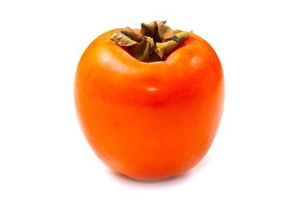 persimmon: caqui fruta en el fondo blanco Foto de archivo