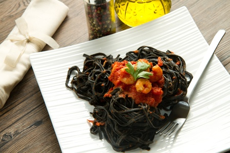 black pasta  with tomatoes sauce and shrimp photo