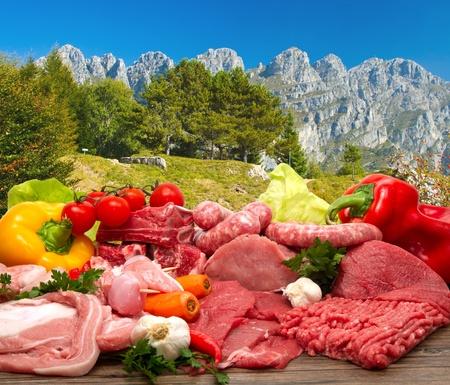 veal sausage: Fresh butcher cut meat assortment garnished