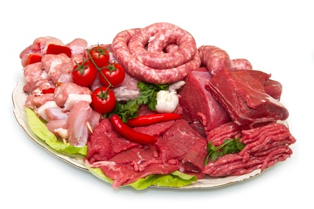 raw meat: Fresh butcher cut meat assortment garnished