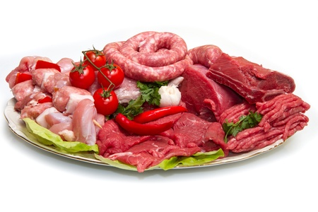 Fresh butcher cut meat assortment garnished   photo