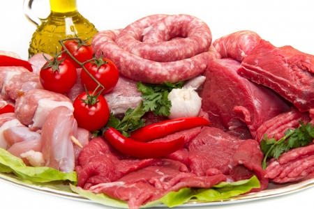 beef meat: Fresh butcher cut meat assortment garnished
