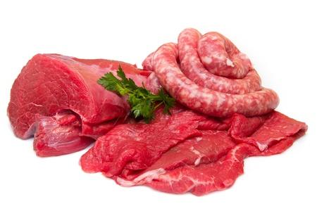 Fresh butcher cut meat assortment garnished   photo