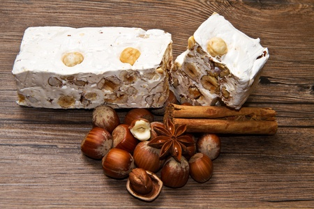 whim: nougat with hazelnut on wooden table