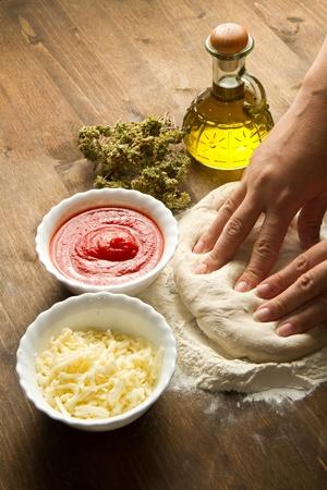 Preparing pizza dough photo