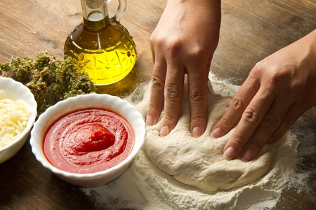 Preparing pizza dough photo