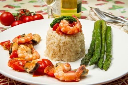risotto with shrimp, mussels and asparagus  photo