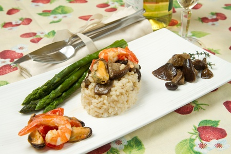 risotto with shrimp, mussels, asparagus and mushrooms photo