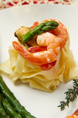 pasta with shrimp, mussels and fresh asparagus Stock Photo