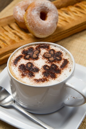 cappuccino with donuts and strudel photo