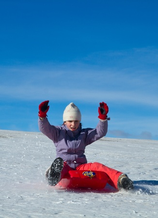 january 1: A girl sliding in the snow
