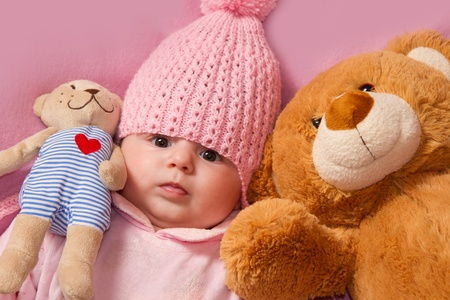 Little girl  with her teddy bear  photo