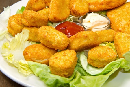 nuggets with ketchup and mayonnaise Stock Photo - 12117666