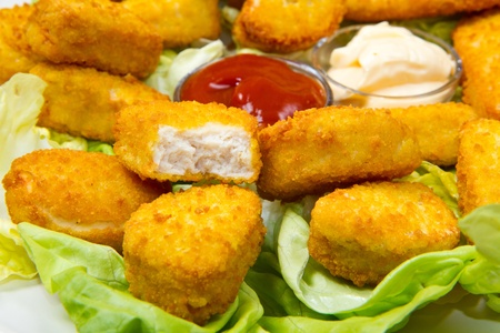 nuggets with ketchup and mayonnaise Stock Photo - 12117665