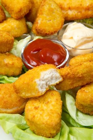 nuggets with ketchup and mayonnaise Stock Photo - 12117660