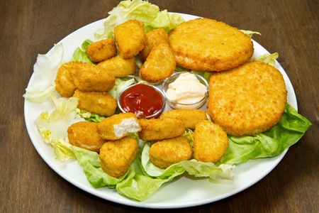nuggets with ketchup and mayonnaise  photo