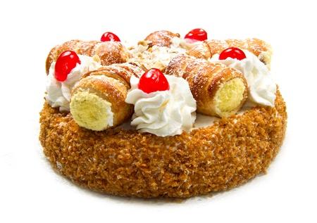 decoracion de pasteles: pastel con crema batida y bollos de crema Foto de archivo