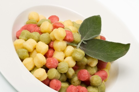 Tricolour gnocchi with sage photo