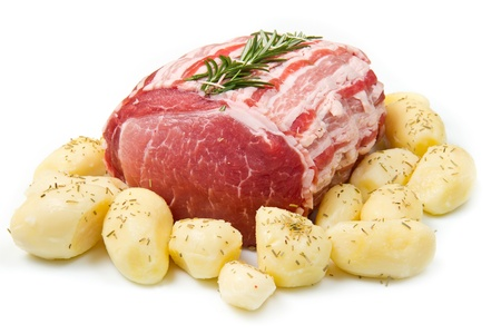 fresh roast of veal with rosemary and  potatoes photo