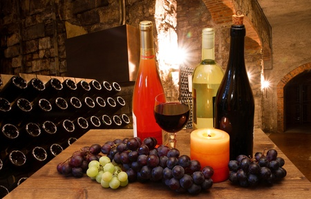 wine grower: glasses of wine in the cellar Stock Photo