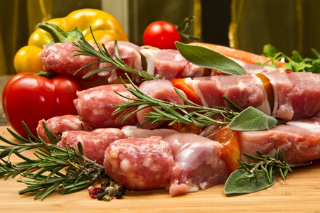 Meat and pepper skewers on a wooden cutting board Stock Photo - 12841694