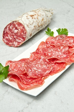 Salami sliced on marble table Stock Photo - 13296902