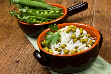 crock: risotto with peas in crock Stock Photo