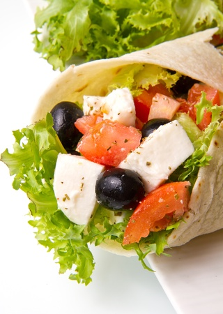 vegetarian piadina with fresh salad, tomatoes, olives and mozzarella cheese photo