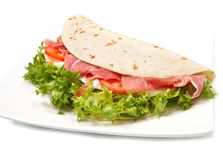 italian piadina with ham, fresh salad and mozzarella cheese photo