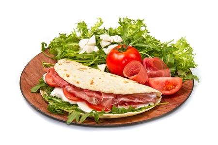 piadina italiana con jam�n, ensalada fresca y queso mozzarella photo