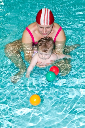 Young family with baby having fun in the swimming pool Stock Photo - 13413579